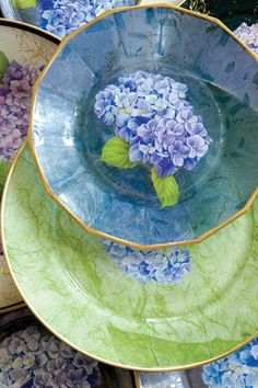 Learn the Art of Decoupage via Victoria Magazine I'm imagining that you could make an entire expensive looking dinner set from dollar store plates and elegant scrapbook papers.