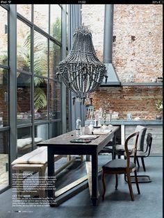Gorgeous chandelier against exposed brickwork from Living etc magazine.