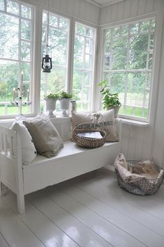 White cottage sunroom. I love the windows.