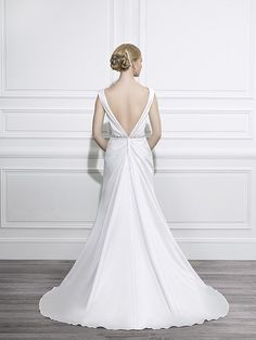 Moonlight+Style+T647 Satin+cap+sleeves+plunge+into+a+V-neck+and+dips+into+a+deep+V-back+on+this+gorgeous+trumpet+silhouette.+A+beautifully+beaded+trim+accents+the+natural+waist.+