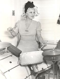 1930s Mae West playing the drums