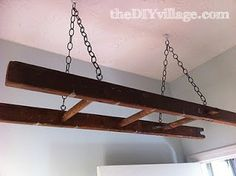 Jacque and I recently were able to get a set of window washing ladders that her grandfather used in his cleaning company. We've re-purposed one of the ladders as a drying rack for the laundry room.      We secured ceiling hooks with toggle bolts to the ceiling
