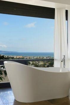 Contemporary Master Bathroom with High ceiling, limestone tile floors, Freestanding, Master bathroom