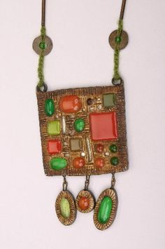 HIGGINS ART GLASS NECKLACE/PENDANT| Pendant height 5'', width 3 1/8'', with rope 22 3/8'', from the Frances S. Higgins estate.