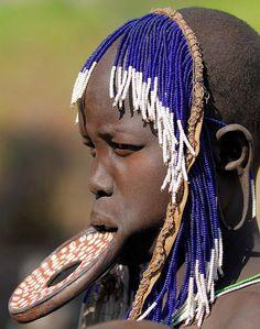Women's beauty ornament in the Tribe Murzi (Ethiopia)
