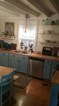 My farmhouse kitchen redo. Painted blue cabinets, tongue and groove countertop.