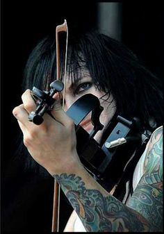 Jinxx playing the violin.
