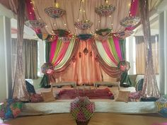 Sangeet Event Decorations | Indian Inspired Backdrop & Hanging Umbrella Canopy at Raja Sweets in Hayward, CA.