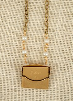 "exvoto vintage messenger necklace with envelope locket, ""I Love You"" letter, and freshwater pearls"