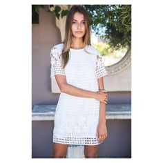 White Fox Boutique White Dress Description - Crochet Overlay Shift Dress - Sheer Sleeves - Relaxed Fit - Minimal Stretch Fabric  Fabrication Polyester  Sizing Model is a Size (S) & is wearing a Size (S) Model is 175cm Tall White Fox Boutique Dresses Mini