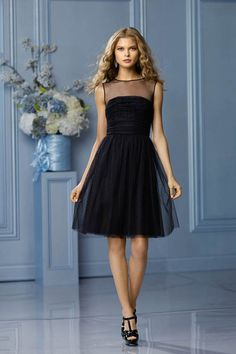 Illusion bateau neckline, keyhole back with shirred, above the knee length skirt. Also available in floor length.