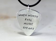 Aluminum Guitar Pick Pendant Handmade with When Words Fail Music Speaks Guitar Pick Jewelry, Guitar Pick Necklace, Music Jewelry, Necklace Box, Guitar Pics, Metal Stamping, Leather Cord, Handmade Necklaces, Teacher Gifts
