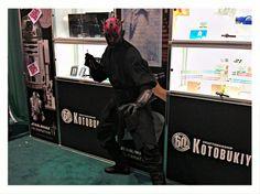 Darth Maul wielding his red lightsaber chopsticks at the Kotobukiya booth.