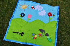 Baby play mat.  Love that there is stuff to actually play with on this!