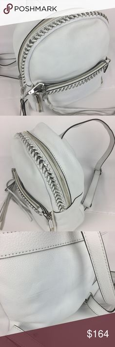 "Rebecca Minkoff White Small Lola Chain Backpack Condition: New, without tag. Never used. Some marks from shipping/handling on the back of bag. See photos. It is a lovely piece, with just a few marks on the back. Exterior: B+  Interior: A  Leather-wrapped chain link trim and tasseled touches adorn our super-sleek (and super-exclusive) mini backpack. Top handle, adjustable backpack straps. Zip closure; lined. Interior zip pocket, slip pocket. 9""L x 3""W x 9.5""H; 2"" handle drop. Removable…"