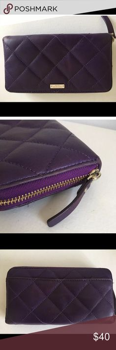 """Kate Spade purple quilted zip around wallet KATE SPADE Purple Quilted Leather Zip Wallet   Condition:Excellent. Minor wear on interior from use. No scuffs or discrepancies.   Details:  • Exposed zip around closure with zipper pull  • Silver Kate spade nameplate on front  • Soft quilted leather outer  • Tan polka dotted fabric interior  • Interior zippered change compartment  • Ample slots  • Imported  • Measures: 8"""" wide X 4.5"""" height kate spade Bags Wallets"""