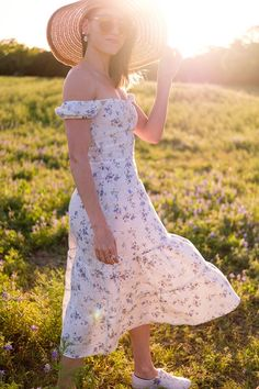 Golden hour photography in Texas hill country bluebonnets. Wearing a floral linen off the shoulder dress from Reformation and Keds sneakers; sustainable fashion brands #linenlover #linenoutfits #sustainablestyle