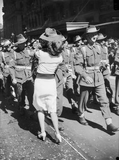 A girl interrupts the march of the 9th Australian Division with a kiss. Melbourne, 1943.