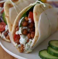 This Roasted Chickpea Gyros recipe is an easy and delicious Mediterranean inspired wrap with refreshing tzatziki sauce. The perfect vegetarian dinner or lunch! // Live Eat Learn recipes Vegetarian Roasted Chickpea Gyros (under 30 minutes! Vegetarian Sandwich Recipes, Veggie Recipes, Lunch Recipes, Whole Food Recipes, Cooking Recipes, Healthy Recipes, Vegetarian Wraps, Vegan Wraps, Vegetarian Recipes For Dinner