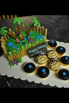 Jungle themed cake and cupcakes