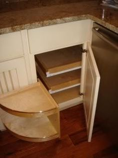 A Corner Cabinet With Pull Out Drawers.