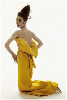 Audrey Hepburn 1963 vintage fashion style color photo movie star in yellow couture designer dress gown long strapless backless satin modern unique style 60s
