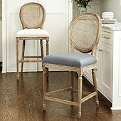 The Louis Barstool frame is handcrafted of solid oak with curved, double-caned back and tapered fluted legs.