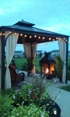 wooden gazebo-one side open and one side curtained (shed side ... - Patio Gazebo Ideas
