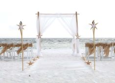 White sashes and starfish contrast with the rustic burlap for a modern twist on a stylish beach wedding