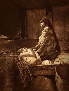 Chief's daughter - Skokomish, by Edward Curtis. Edited by Dredsina.  The Skokomish Tribe is now based in the Skokomish Indian Reservation, on the Olympic Peninsula in Mason County, Washington.