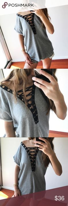 """Cozy Grey Criss Cross Top Features black criss cross detail & gold hardware. Fabric feels medium weight but the middle opening lends the top an airy feel, so these equalizing forces allow this top to be worn any season if styled accordingly! Wear with a lace bralette that will peek through or silicon sticky cups (what I used).  -Contrasting Grey and Black -70% cotton, 30% polyester -Measurements of a S for reference: 26"""" shoulder to hem; 19.5"""" pit to pit  Modeling a size S My measurements…"""