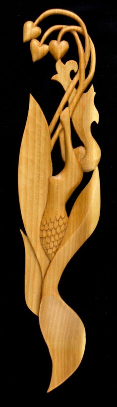 Mermaid. Based on a sketch by artist, Jan Beuhler, this elegant mermaid is shown playfully rising from the depths. Fully carved both sides.