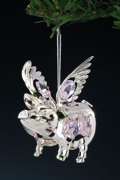 Our hilarious and whimsical Swarovski Spectra Pink Crystal Flying Pig Silver Christmas Ornament is our best seller, year after year. The purple crystals are nicely sized, measuring inches in diameter. The ornament measures tall by inches long. Silver Christmas, Christmas Ornaments, Pot Belly Pigs, Dog Jewelry, Jewlery, This Little Piggy, Flying Pig, Cute Pigs, Pig Stuff