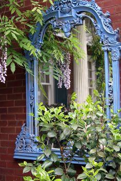 love this blue painted mirror reflecting the porch columns...Garden in Savannah, Georgia. Photos: Daisy...