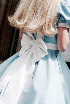 There is nothing like a bow and a blue dress to make me think of Alice and Wonderland.