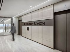 Gensler designed the new offices for law firm Stradley Ronon located Philadelphia, Pennsylvania. Stradley Ronon embraced the opportunity for a cultural Office Entrance, Office Lobby, Ceiling Design, Wall Design, Lift Design, Modern Interior Design, Interior Architecture, Elevator Lobby Design, Visual Merchandising