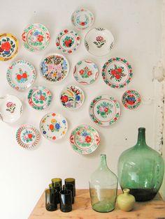 Vintage wine bottles and antique folk plates