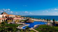 Cancun Vacations - Ocean Coral and Turquesa All Suites Resort -  All Inclusive  - The luxury resort features 7 restaurants, 4 pools, a full-service spa, and a fitness center, along with spacious rooms and suites.
