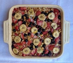 baked oatmeal with strawberries, blueberries, and banana.