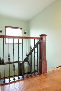 Stair Systems | wood staircase with wrought iron balusters | Bayer Built Woodworks