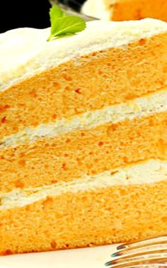 Orange Cream Cake with Cool Whip Pudding Frosting ~ light, fuffy and full of citrus flavor! The zesty tanginess of this moist cake tastes like orange sorbet and makes a mind blowing dessert for any occasion!