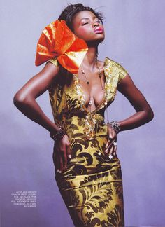 Tear sheet from True Love West Africa Mag. Gold and Brown Damask Dress.