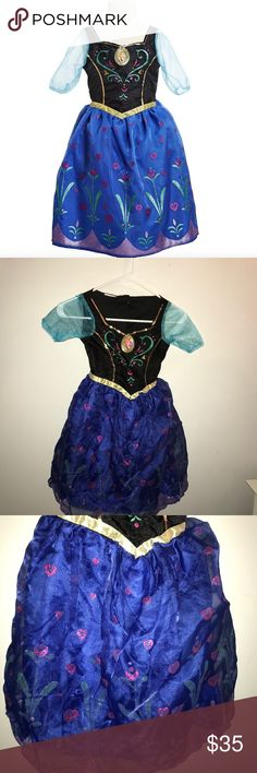 """Disney Frozen Anna Musical Light Up Costume Dress Fits toddler girls size 3-4 This beautiful Anna dress features magical motion-activated lights and music! Watch her twirl as the dress lights up and begins to play Anna's iconic song """"For the First Time in Forever!"""" Anna's dress also features sparkling fabric with a beautiful flower glitter print, the perfect addition to her dress up collection! Requires 3 x AAA (R03) batteries Disney Costumes"""