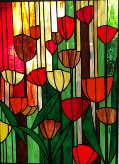Tulips – stained glass panel – Connie Haugrud Flairty Tulips – stained glass panel Tulips – this is a wonderful colorful panel, joyful and optimistic. Of course, it is possible to frame it and illuminate. Stained Glass Flowers, Faux Stained Glass, Stained Glass Designs, Stained Glass Projects, Stained Glass Panels, Glass Painting Patterns, Glass Painting Designs, Broken Glass Art, Sea Glass Art