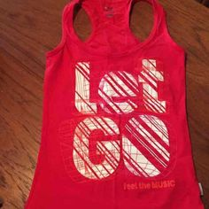 Zumba tanks Perfect condition wore once for a event size small and was limited edition for either a heart even or Diabeties can't remember Zumba Tops Sweatshirts & Hoodies