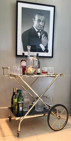MAISON JANSEN bar cart in James Bond style. For Vintage Bar Carts and Crystal glassware from Europe think: Petra Boutique Finds. We have from champagne glasses, flutes to martini coupes, whiskey glasses and cognac glasses. Find your style now. Home Bar Decor, Bar Cart Decor, Petra, Bar Sala, Antique Mirror Glass, Bar Trolley, Gold Bar Cart, Brass Bar Cart, Drink Cart