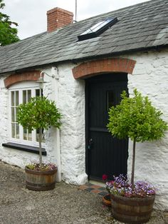 Looking fir ideas to dress up my irish cottage 'altar' Barn Cottage ~ Adare Irish Cottages square door, but rounded lentil. Door on interior of bale to create tiny protected overhang for weather.