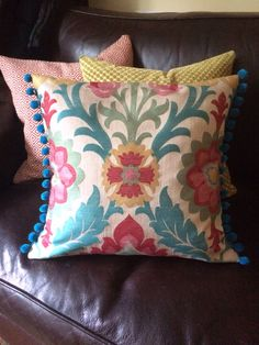 Another cushion in my attempt to brighten the hideous leather sofa. Trying out pompom trim.