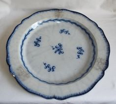 Large antique Georgian pearlware feather edge painted 15  charger plate.,generally in good condition with no cracks but a small rim chip,three areas of grittiness to the glaze where the stilts have been for stacking the plates in the kiln,one lot of gritty glaze with burst glaze bubbles, £16