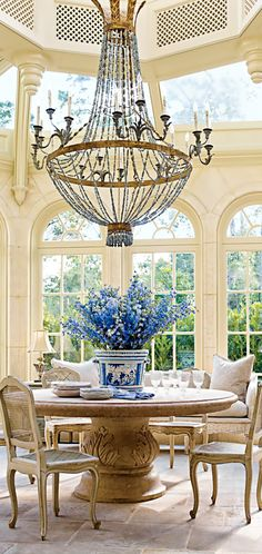 This Dining Room Is All About The  Chandelier!! Although The Windows Are Awesome,Tall Ceilings.. Lovely Touch Of Blue!!!